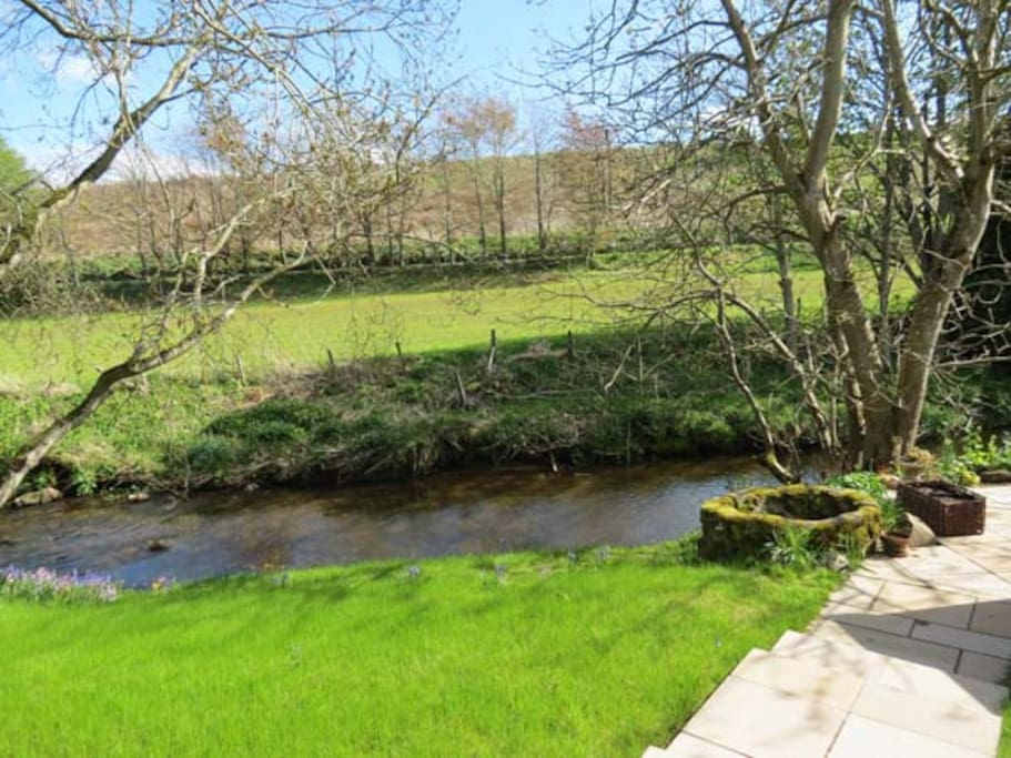 The cottage garden leads down to the river Carron