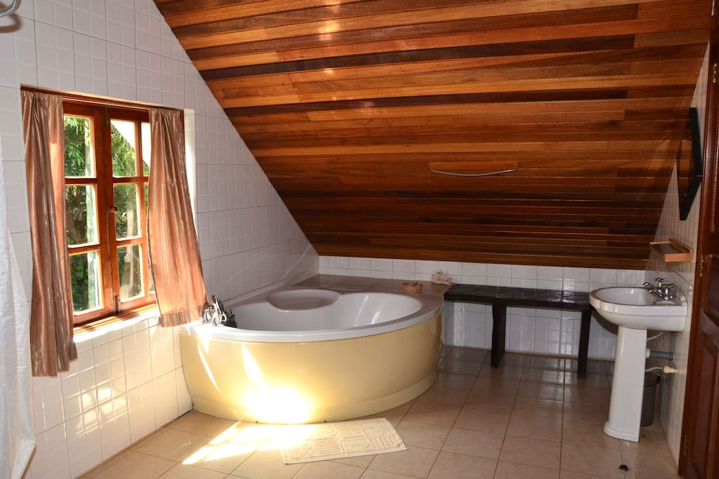 Upstairs bathroom features shower as well as bathtub