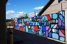 Sixty foot mural by JB Snyder.