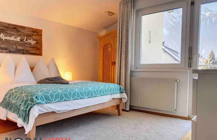 Bedroom nr 1 double bed, walking closet and terrace with view on the mountains and garden (master bedroom)