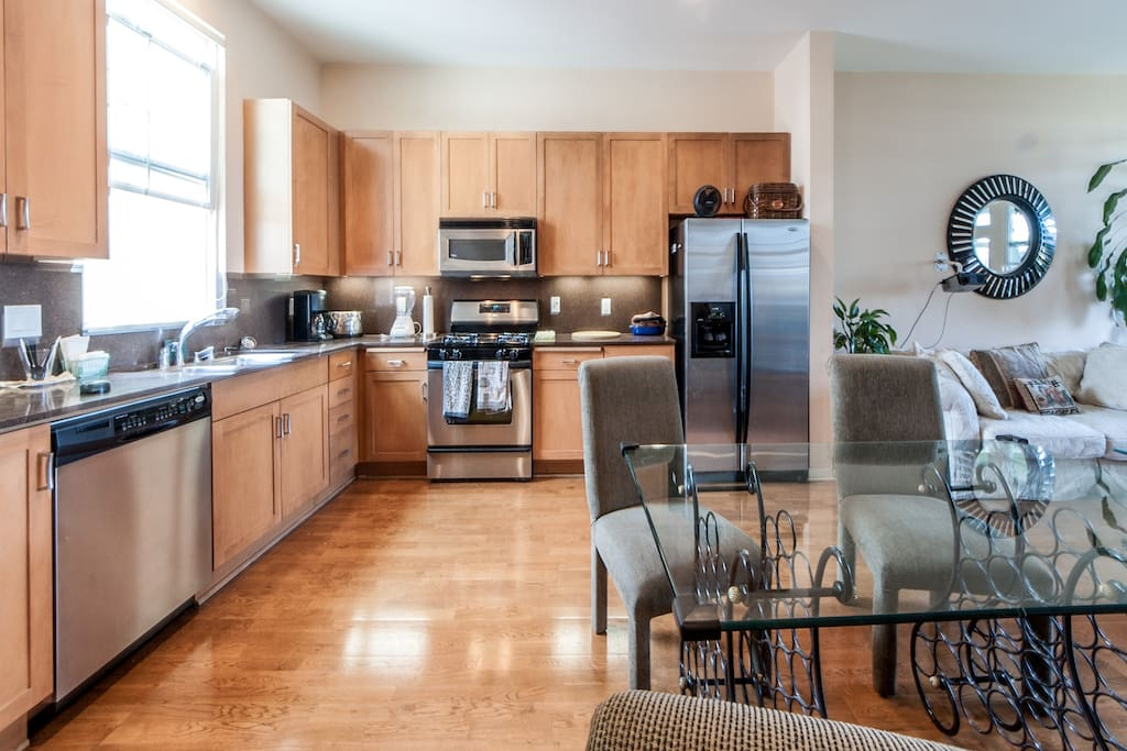 This gorgeous kitchen, with hardwood floors and granite counter-tops, is the perfect place to cook up a big meal for friends or simply reheat leftovers for yourself.