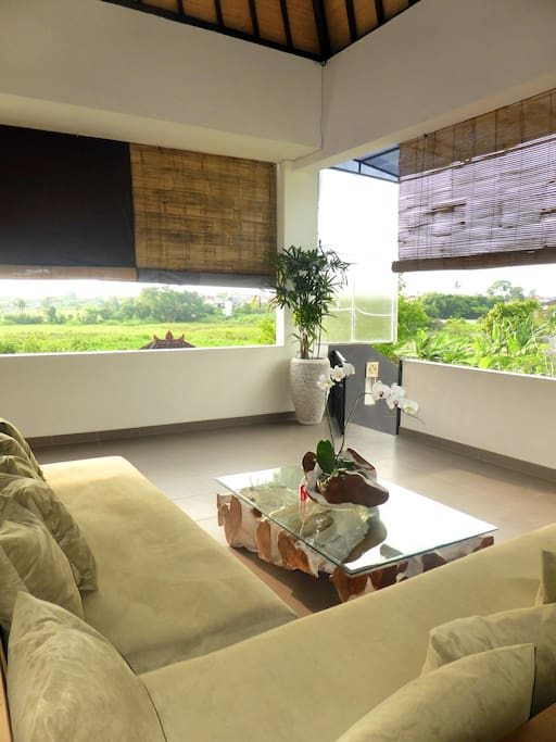 We love to chill on the sofa in the Lounge. You oversee the ricefields and see directly in the sunset.