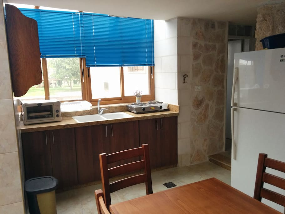 This is the kitchen. The bathroom is on the right. Also notice the garden area outside.