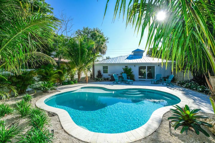 Adorable 3 bedroom home, steps to the best beach access! Private backyard pool!