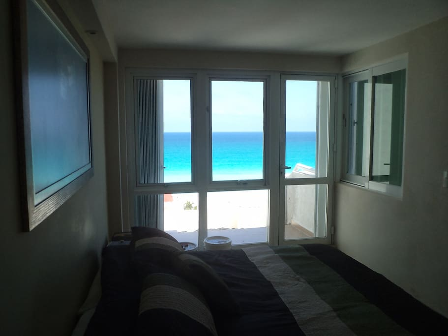 View of the caribbean sea from main bedroom.