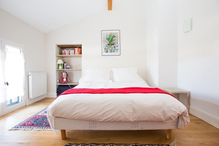 Red bedroom overlooking the garden