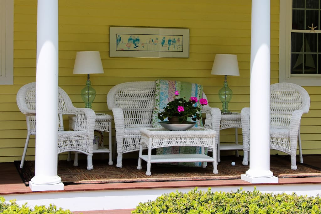 Sip a Cocktail on our wrap-a-round porch.
