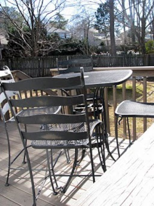 Outdoor seating for eight and a grill!