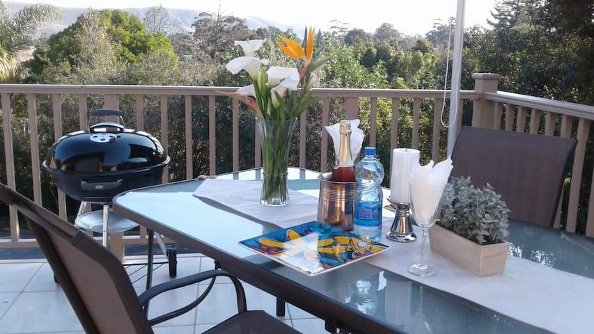 Balcony with patio set.