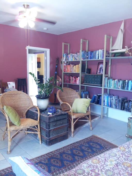 LIVING ROOM, furnished with our library of books, comfortable chairs, tables and sofa.