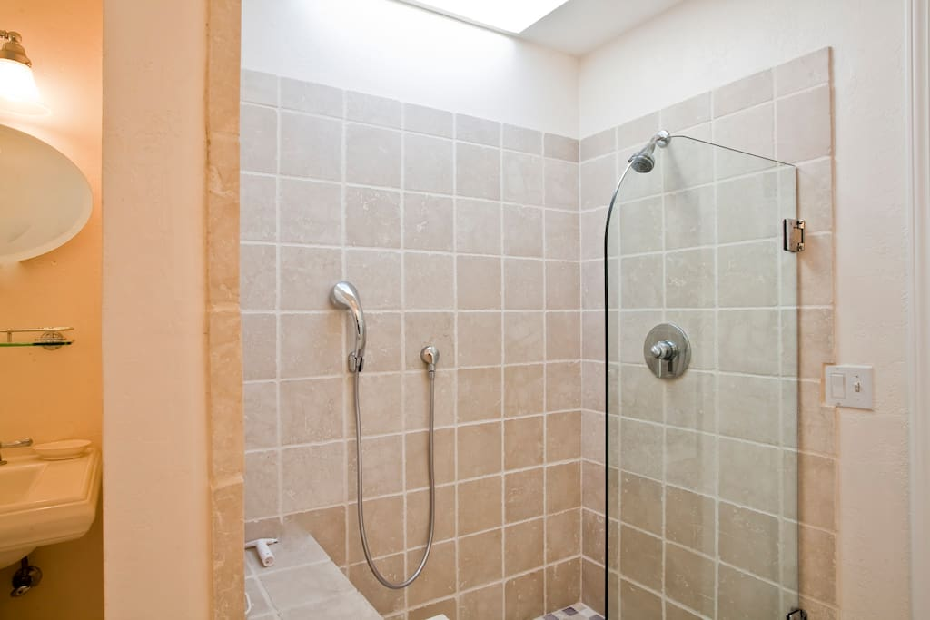 Italian marble walk in shower with skylight and bench - both handheld and overhead shower