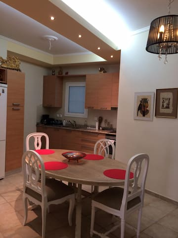 Fully stocked updated kitchen with open concept dining area