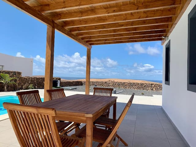 Relax in Stylish Villa with Heated Pool, and Views