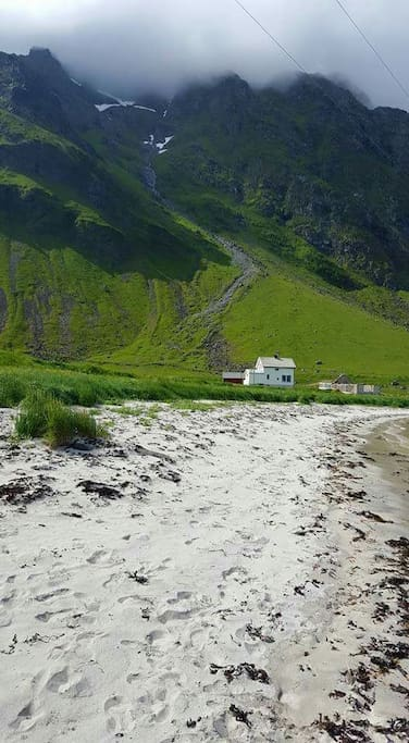 A little white house between mountains, the ocean and a beach. Wild and cozy :)