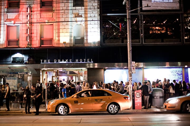 Drake hotel is opposite the apartment. Great drinks, food and live music.
