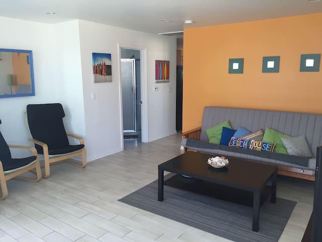 living room into hallway with futon