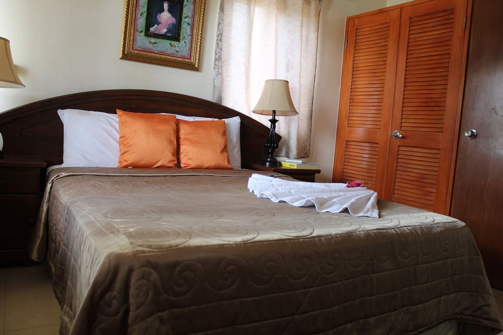 Comfortable queen sized bed where you can rest in air conditioned comfort.