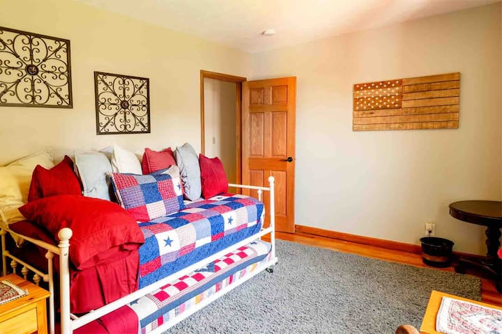 Bedroom #3 has a daybed with a second single bed on a trundle.