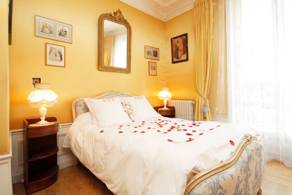 Yellow bedroom with balcony