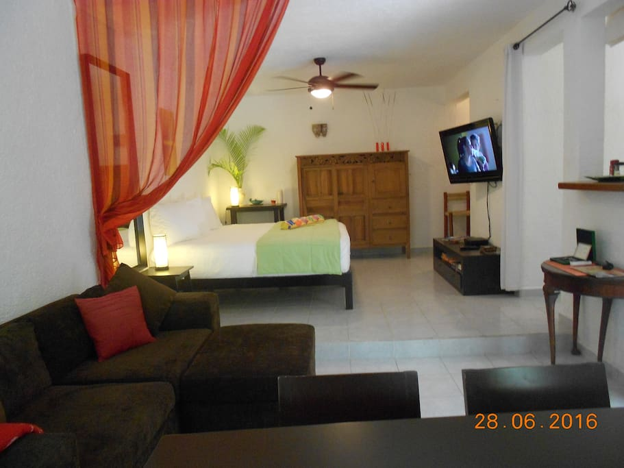 Suite with living room/dining room and separate sleeping area with 49 inch TV