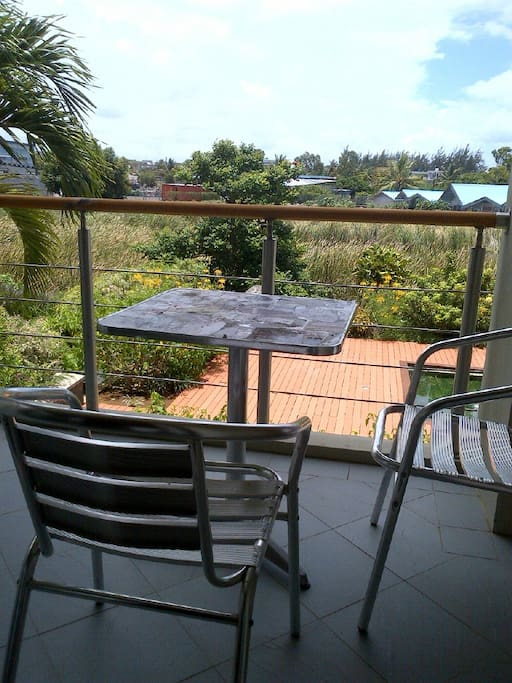 one of 2 private balconies overlooking a  wetland and main pool