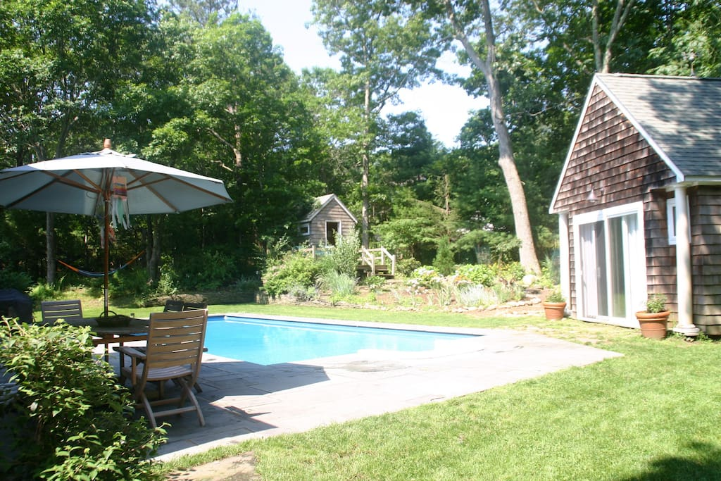 Cottage looks out onto the pool in summer months