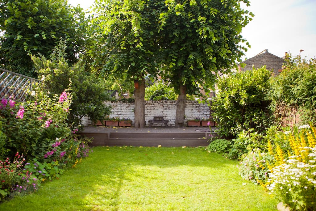 Large walled garden with grass and hardwood decking. Patio area just outside kitchen. Trees shade the garden nicely in the summer. Flowers galore in the spring/summer.