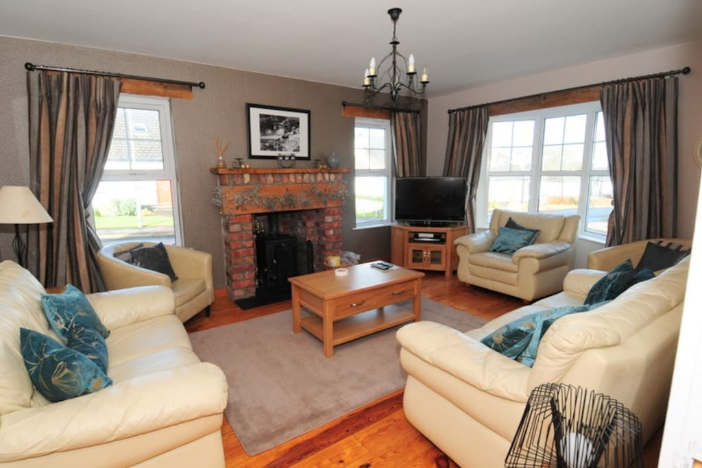 Lounge with wood burning stove, HD TV, Sony DVD player with USB & sound systems for smart phones & tablets.