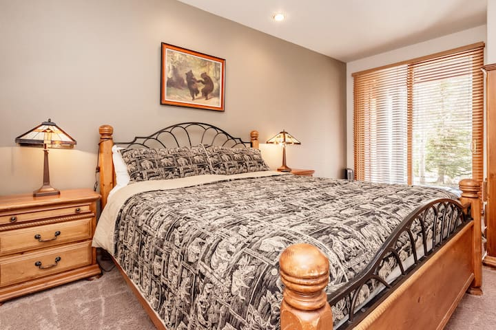 Queen Bed in Master Bedroom 2 downstairs with private deck looking to forest service lands.  Includes large closet and TV with cable.