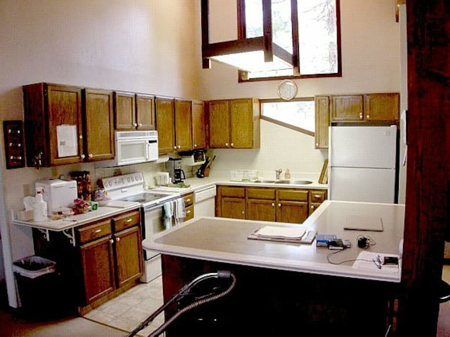 Spacious fully equipped kitchen with counter seating