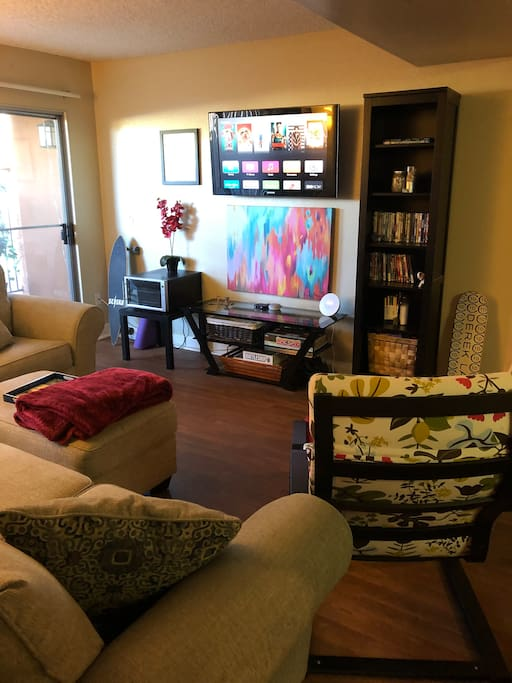 Mounted flat screen with Apple TV, Netflix, you tube, Hulu and so much more... Just sign in! Our Netflix and YouTube is shareable so help yourself. You can see a nice large patio with a bar and seating for six. Wii and DVD player as well!