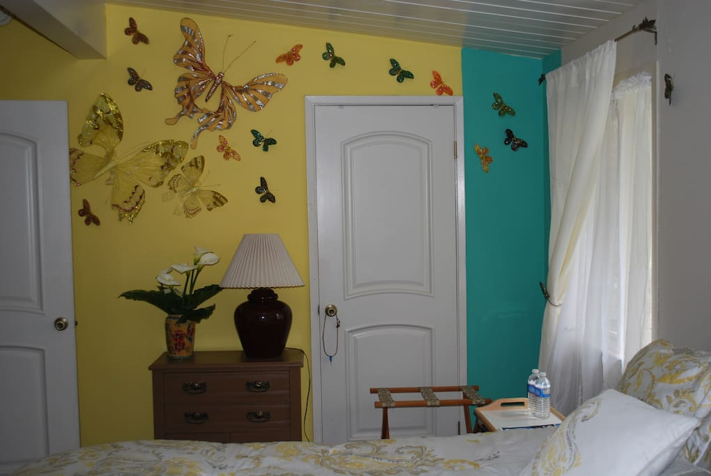 Left wall when you walk-in with butterflies on the wall.