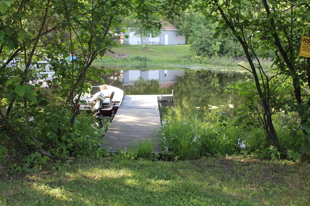 View of the pier from the picnic area (this boat not included in rental - Pontoon, canoe & Kayak for rent)