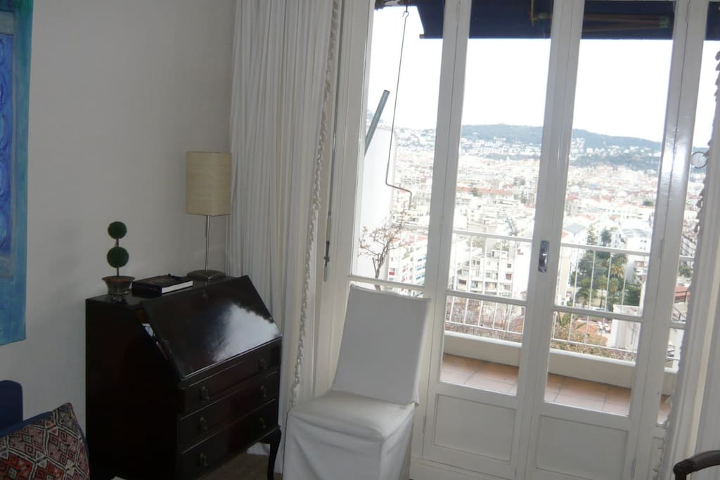 The Living room overlooking the balcony and views over all of Nice!