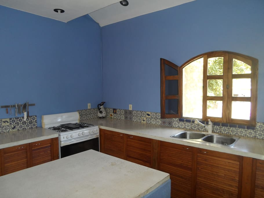 Fully-equipped, large, light and colorful kitchen.