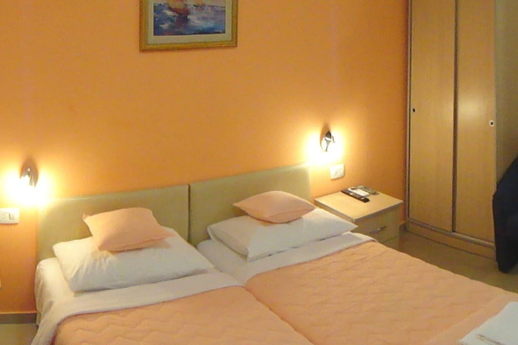 private room with two single bed's , private bathroom , fridge , balcony...etc