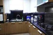 Kitchen with RO Water Purifier, Microwave, Fridge, Washing Machine, Rice Cooker, Blender, Coffee Maker, Water Jug, Utensil and Kitchenware
