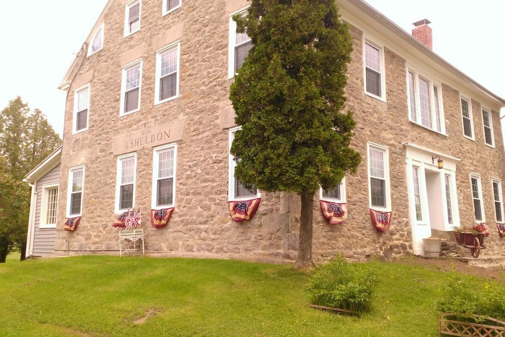 Thistle Dew is a historic stone house built on the old stage road in 1809 by J Sheldon.  Located on 284 acres of field and forest this is a quiet country retreat in a picturesque setting.
