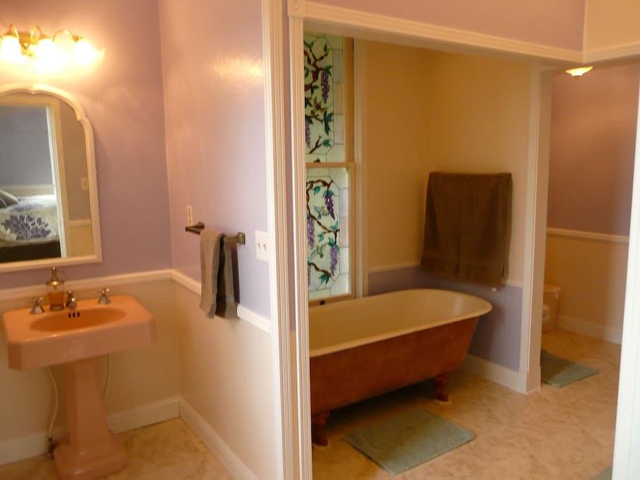 Private bathroom for Garden View Room includes large claw-foot tub and shower stall (not visible in this view).