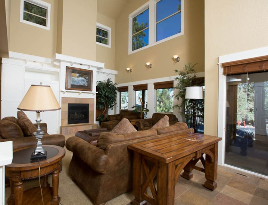 Large open Living Room that opens to Kitchen and Dining Room.  Vaulted Ceilings and Gas Fireplace.