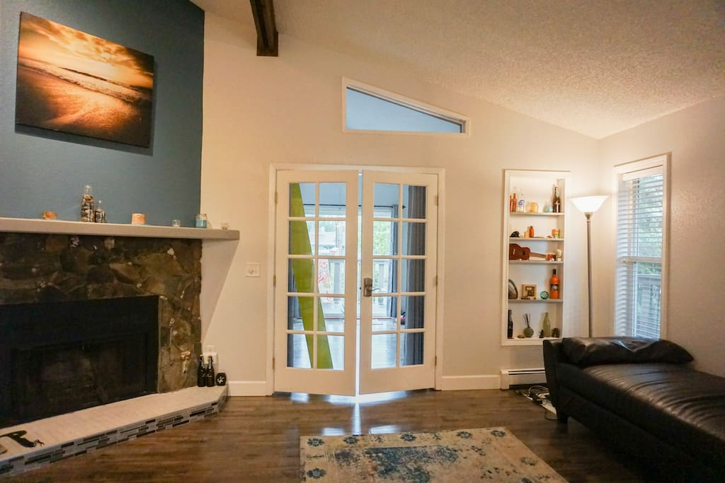 The french doors leading to your sunroom/loft, which also houses a 3/4 bathroom, a sauna, and access to our deck.