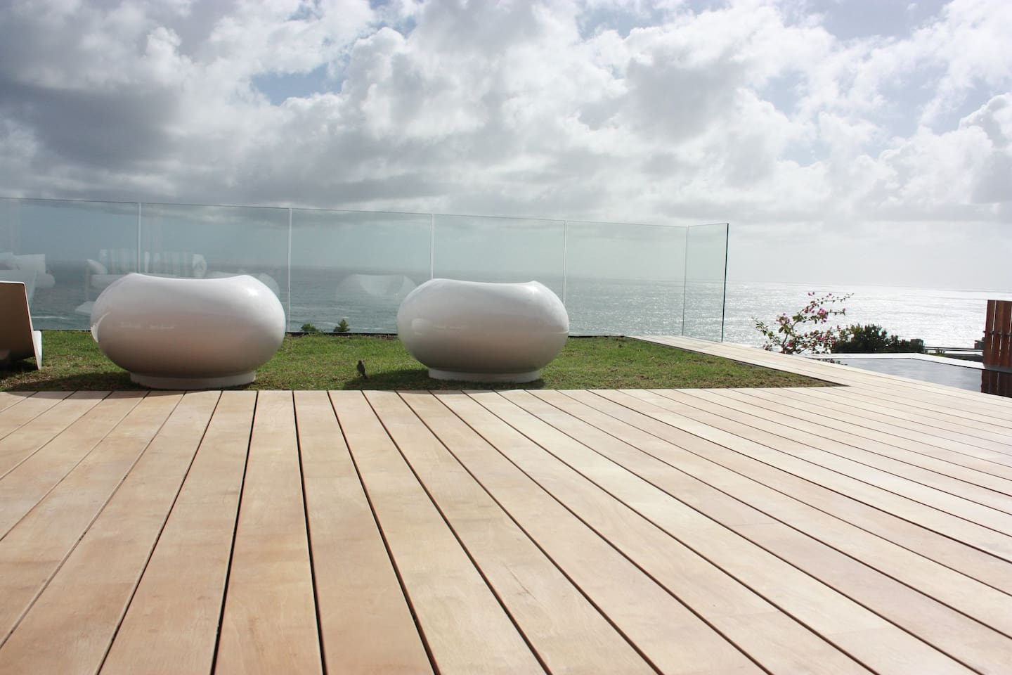 Enjoy this magnificent deck with a view of the Atlantic Ocean in the background