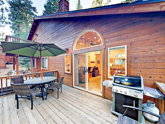 The back deck has a gas grill and a 4-person dining table for cookouts.
