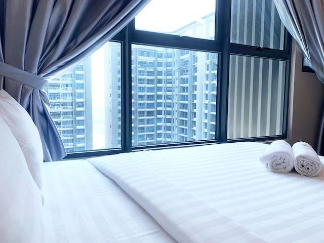 Queen size bed 1 with swimming pool view