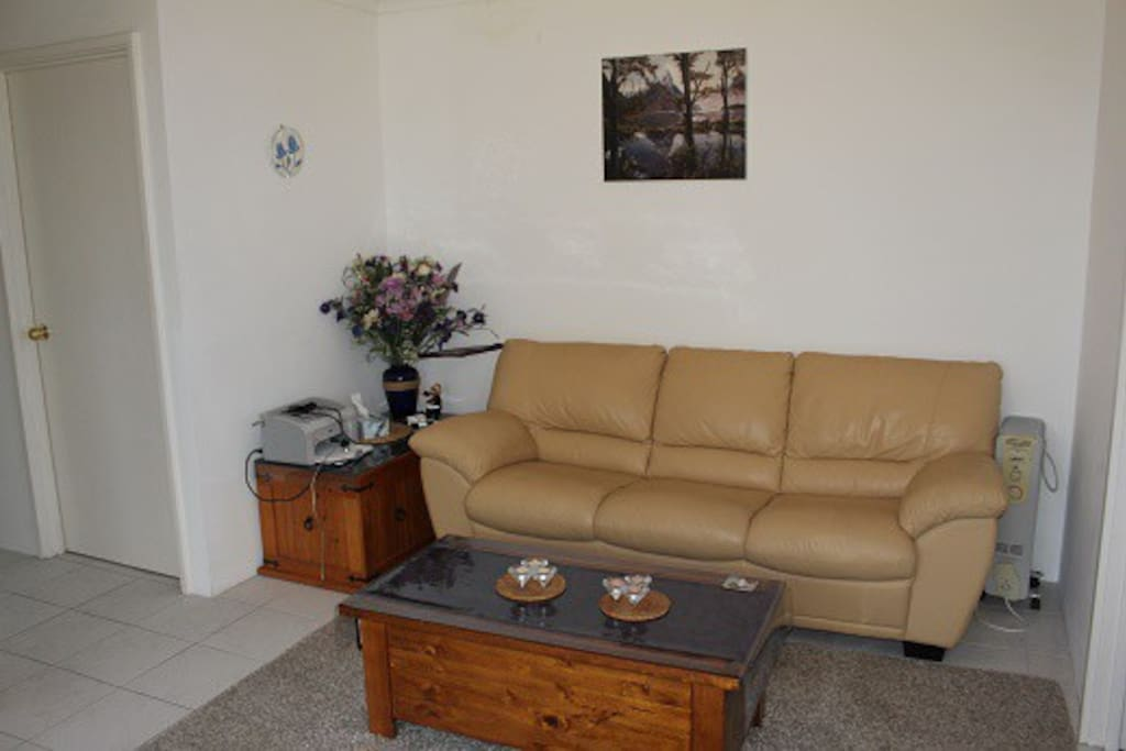 Separate lounge with 40 inch TV for guests.