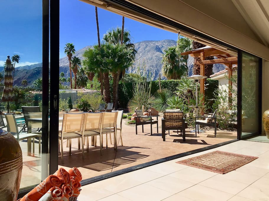 This wall of glass in the Huge Great Room disappears creating the Quintessential Palm Springs Indoor-Outdoor Experience