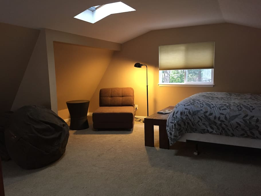 Upstairs Loft with Queen bed. Two fold out chairs turn into single bed mattress pads on the floor.