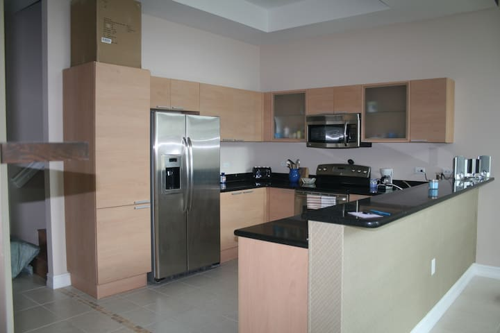 Spacious Modern Kitchen with Stainless Steel Appliances