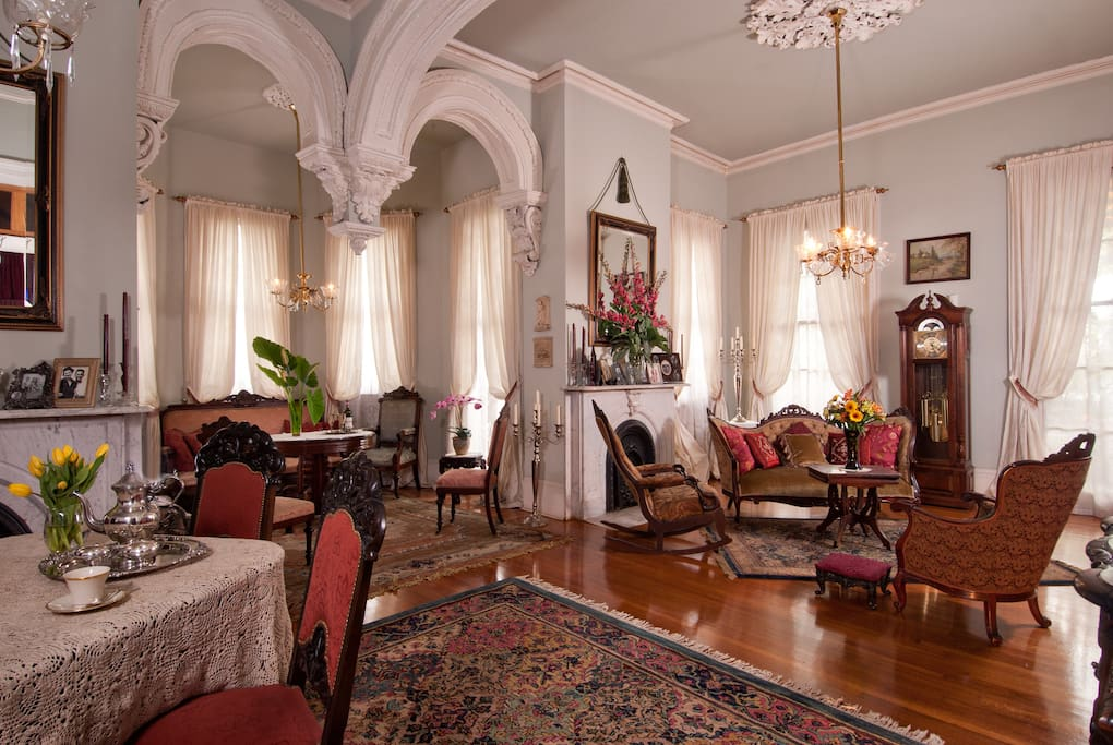 Bask in the elegant grandeur of the home's formal double parlor.
