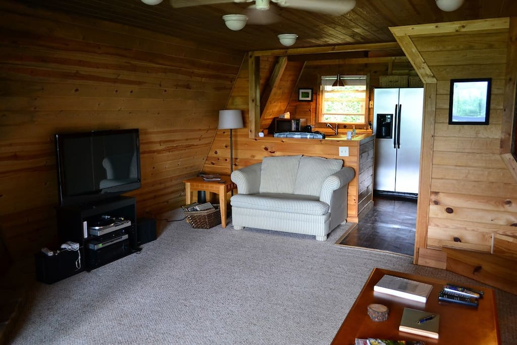 The living area is cozy and has everything you need to be comfortable during your stay.